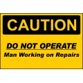 Caution Sign - Do Not Operate Man Working On Repairs